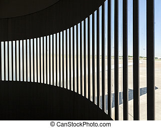 detail of skybridge at airport with shadow