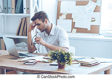 Feeling tired Frustrated young handsome man looking...