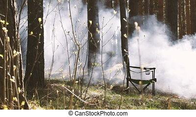 Chair standing in the woods and fells smoke Season video