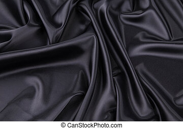 Black silk drapery. Isolated as a whole background.