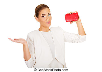 Shocked businesswoman looking into her empty wallet.