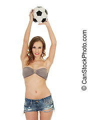 Woman in shorts holding foot ball. - Beautiful woman in...