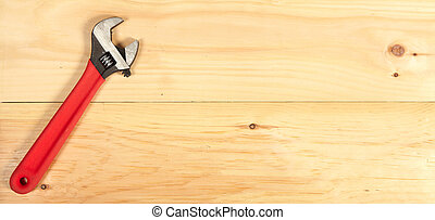 Wrench on wooden background