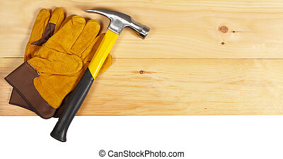 Hammer and gloves wrench on wooden background - Set of...