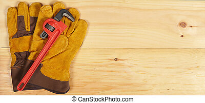 Wrench and gloves wrench on wooden background - Set of...