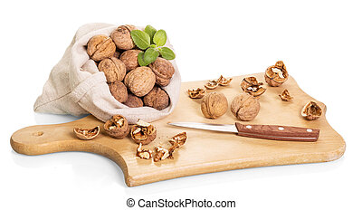 Walnuts, wooden board and knife isolated on white background