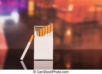 Opened pack of cigarettes close-up on background the...