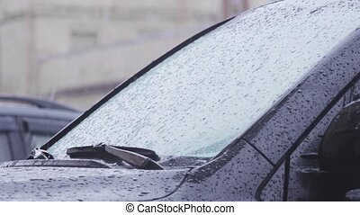 Water droplets on automobile windshield. HD