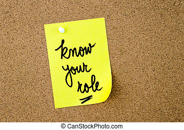 Know Your Role written on yellow paper note pinned on cork...