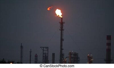 Burning refinery torch - Torch at an oil refinery