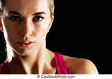 Young woman without make up on gym.
