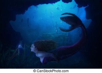mermaid in the deep sea.