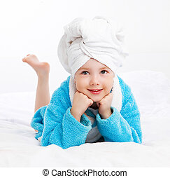 girl after shower - cute girl wearing a bathrobe and a towel...