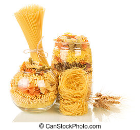 Multicolored pasta in jars isolated on white.