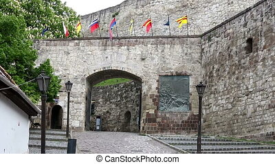 Eger fortress gate and flags