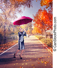 Woman while raining on the autumn street - Woman with...