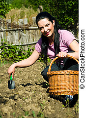 Happy woman working in garden