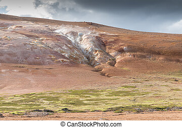 Krafla Mountain Ridge - Steaming rim of a volcanic lava...