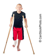Boy with crutches - An injured boy with leg cast smiles...