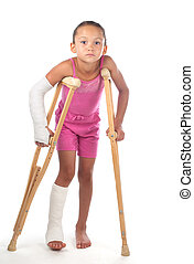 Girl with crutches - A young girl struggles to walk with...