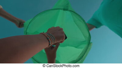 Woman firing sky lantern - Close-up low angle shot of a...