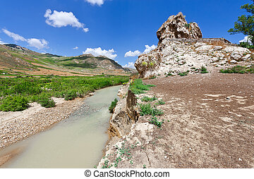 Mountain Stream between the Volcanic Hills of Sicily