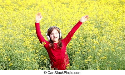 happy little girl enjoy in music