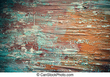 Cracked paint on a wooden plank