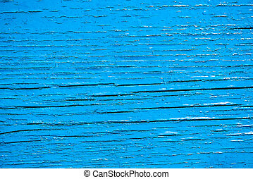 Old wooden planks painted with blue paint with brush fringes