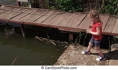 Child with his mother watching frog - Near river daughter...
