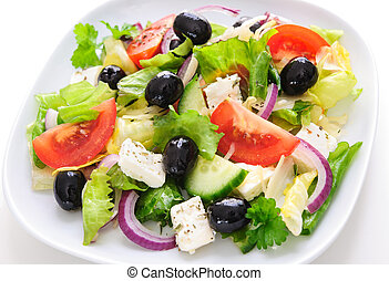 Greek salad isolated on white - Greek salad with cheese in...