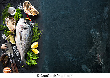 Delicious fresh fish and oysters with aromatic herbs, spices...
