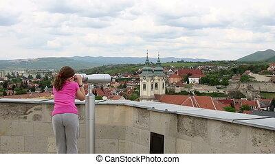 little girl Eger Hungary - little girl looking through...