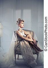 Elegant bold lady relaxing on the retro armchair - Elegant...