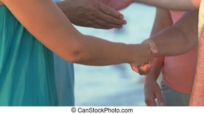 People exchanging handshakes - Several people exchanging...