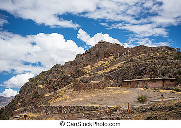 Inca ruins and buildings in Pisac, Sacred Valley, Peru -...