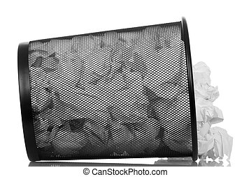 Overturned basket full of waste paper isolated on white...