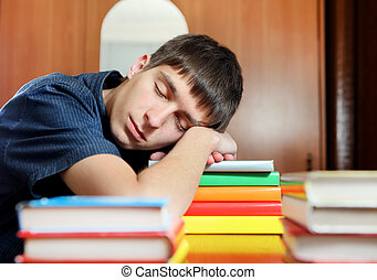 Student sleep on the Books - Tired Young Man sleep on the...
