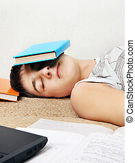 Teenager sleep with the Book - Tired Teenager sleep on the...