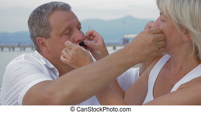 Couple Sticking Moustaches to Each Other Faces - Mature...