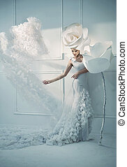 Elegant young lady in a white room - Elegant young woman in...