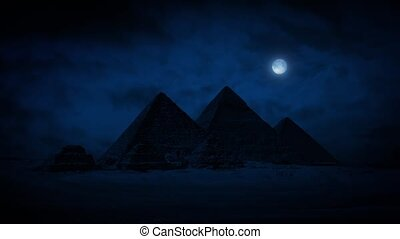 Pyramids At Night With Moon Above - The pyramids of Giza on...