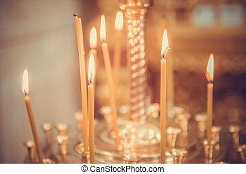 Candles firing in church - Candles firing in the church,...
