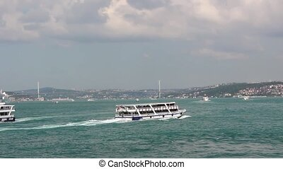 View of Bosphorus, bridge and boats from Eminonu square in...
