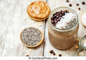 Chocolate Coconut Chia seeds overnight oats on a white...