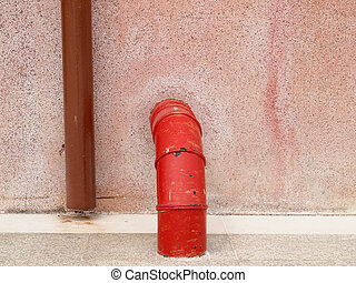 plumbing pipe against stucco wall , industrial grunge background