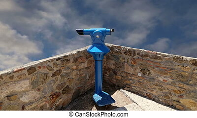 telescope viewer tourist type telescope against the sky with...