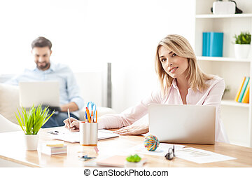 Cheerful young colleagues are working in office - Attractive...
