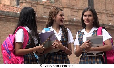 School Girls In Uniform Holding Books
