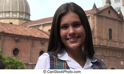 Smiling Teen Girl Near Church